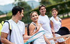 Group of tennis players having fun at the court